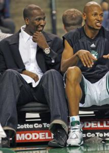 Kendrick Perkins (left) found a safe place to rest his injured toe - sitting next to Ray Allen on the Celtics' bench last night.