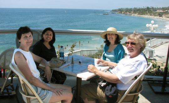 From left, Kathy McIntyre, Linda Hayes, her sister Janet Lurie, and Chris Ward savor Main Beach in Laguna Beach, Calif.