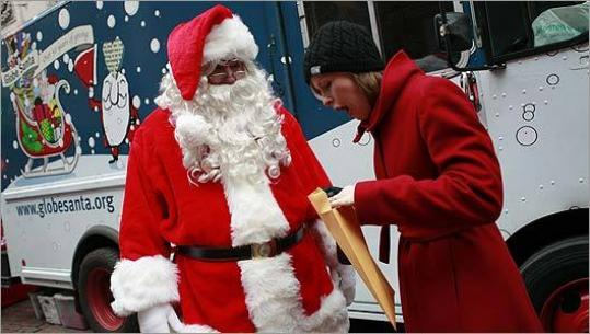 Lisa Hughes got a surprise present yesterday from Globe Santa while he collected donations.