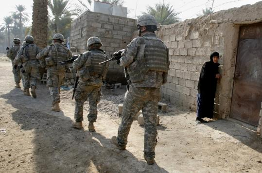 US soldiers patrolled a village during a search for weapons and insurgents yesterday near Baqubah, following attacks on Iraqi police and US-backed patrols.