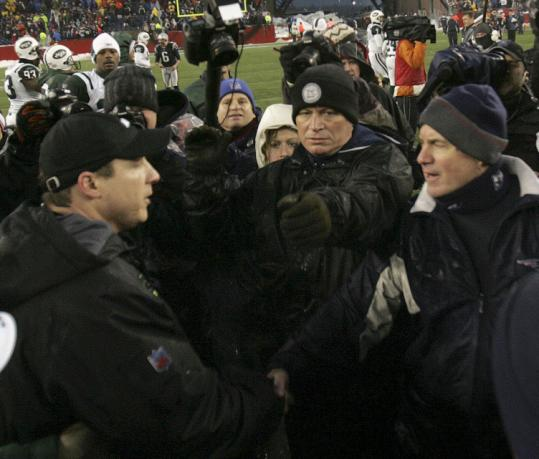 The postgame handshake between coaches Bill Belichick and Eric Mangini failed to produce any fireworks.