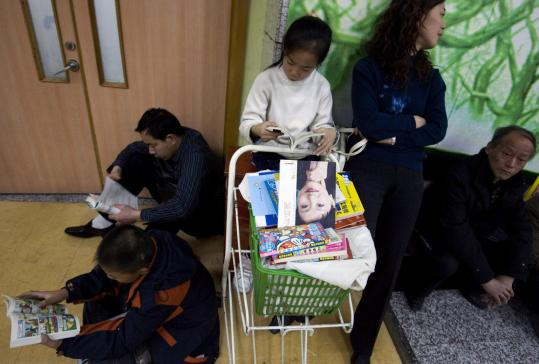 Customers browse at a Beijing bookstore. Voracious demand and a crackdown on small, polluting paper mills have pushed up paper prices by 10 percent this year and forced publishers to raise prices.