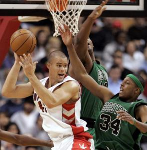 Toronto's Kris Humphries is guarded by Celtics Glen Davis and Paul Pierce. The Celtics lead the league in defense.