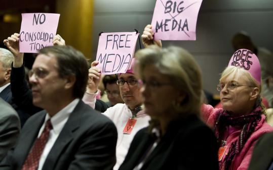 Code Pink members during an FCC meeting about rules that would let firms own a newspaper and television station in the same market.