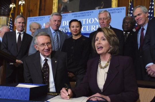 'This is a choice between yesterday and tomorrow,' House Speaker Nancy Pelosi said upon signing the energy bill.