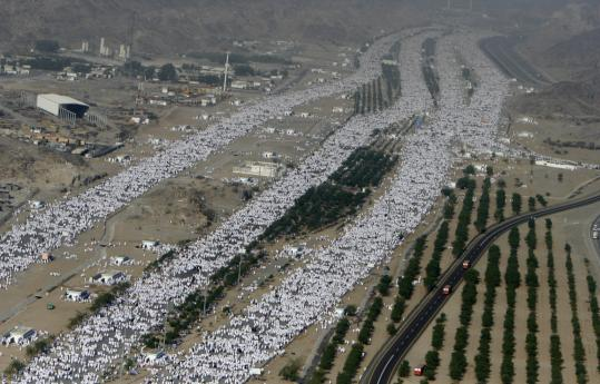 Pilgrims arrived on a plain near Mecca yesterday, as millions of Muslims observed the spiritual high point of the annual hajj. Several hundred Iranians joined in political protests, which were kept strictly under control by Iranian security officers.