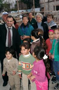 Members of Cambridge- Bethlehem People-to-People visit children in Bethlehem's Aida refugee camp.