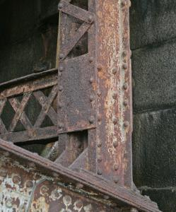 A rust-covered overpass at Charles Circle, observed in March, is just one project among hundreds on the state's work list.