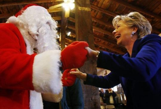 Senator Hillary Clinton, Democrat of New York and presidential hopeful, was greeted by a man dressed as Santa Claus at a campaign stop in Concord, N.H., yesterday.