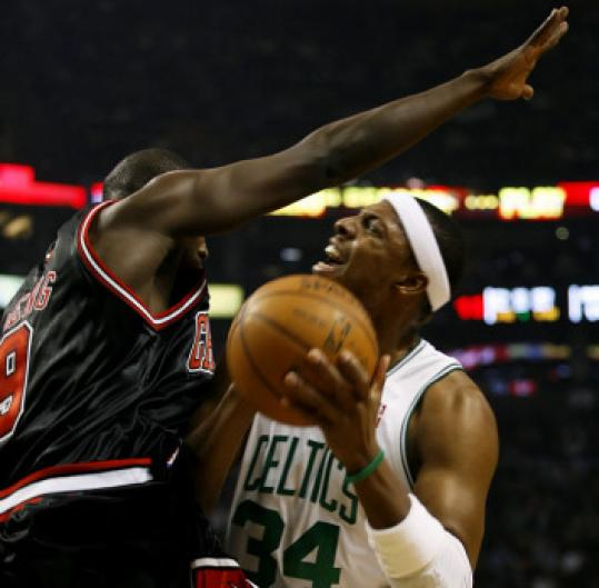 Paul Pierce winces but it's worth the pain: He draws a foul on Chicago's Luol Deng.