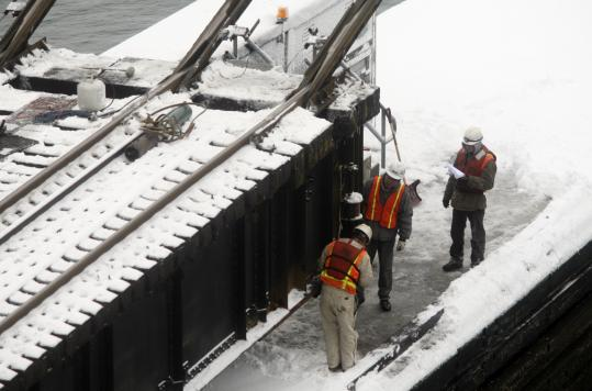 A crew worked on the damaged bridge, moved into its open position for the work. A temporary repair was completed by the evening commute.