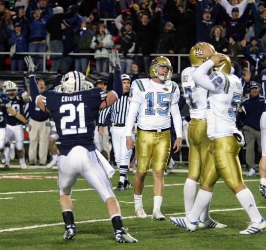 BYU's Ben Criddle celebrates after a field goal attempt by Kai Forbath (15) was blocked.