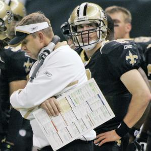 Saints coach Sean Payton and QB Drew Brees didn't help their playoff hopes by losing to the Eagles.