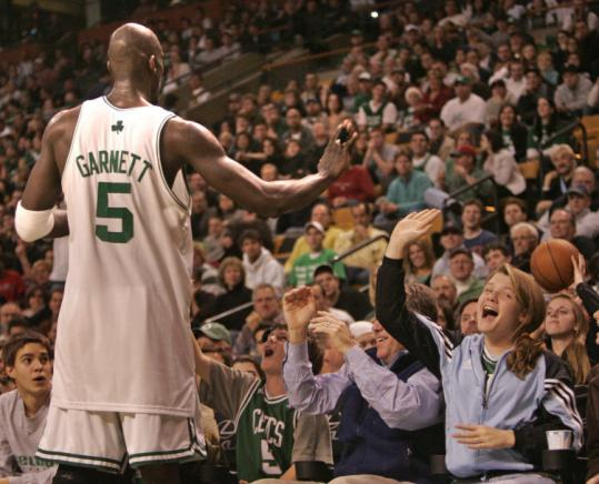 Kevin Garnett (21 points, 12 rebounds) gets an assist from a host of hometown fans after the ball went out of bounds.