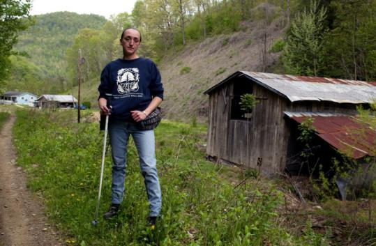 Maria Gunnoe, 39, seen on her property in Bob White, W.Va., in April 2006, has been fighting to stop mountaintop-removal coal mining since her farm was flooded in June 2003. 'Clean coal is a complete and total lie,' said Gunnoe, who has reportedly received death threats.