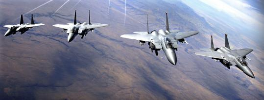 About 450 F-15s, such as these flying in formation in 2005, have been grounded since one of the fighter jets crashed last month. The planes are being checked for defects in metal rails.