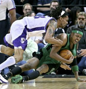 With Sacramento's Mikki Moore in hot pursuit, Paul Pierce hits the ground and takes the ball with him.