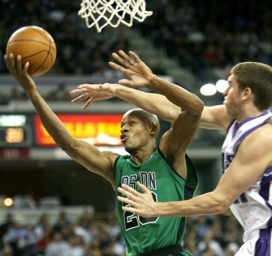 Ray Allen, who had a team-high 17 points, kept Sacramento's Spencer Hawes at arm's length en route to the basket during the first half of the Celtics' 89-69 victory over the Kings last night.