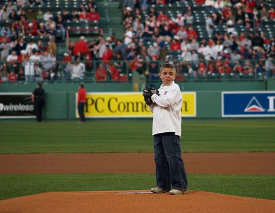 Jett McSherry of Pembroke threw out the first pitch at Fenway before a Red Sox game last year.