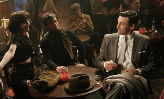 Rosemarie DeWitt, Ian Bohen, and Jon Hamm in 'Mad Men,' AMC's 1960 period piece about Madison Avenue ad men.