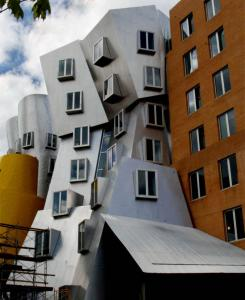 Showy Buildings Go Up While Mit Sues Designer Of Its Own The