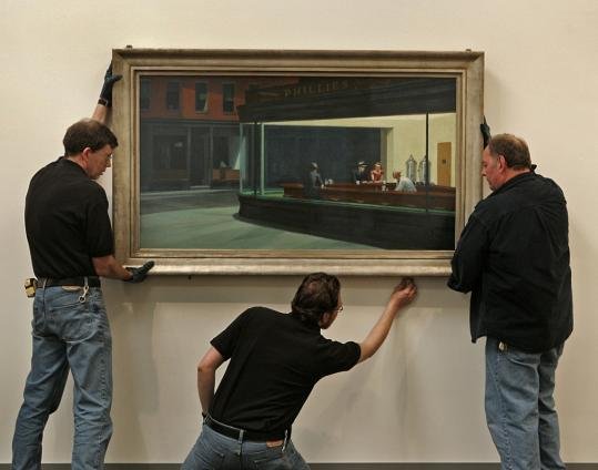 Bob Taylor (left), Luke Cannon (center), and Tom Conlon of the MFA hang Edward Hopper's 'Nighthawks' in April in preparation for an exhibit of the American modernist's paintings.