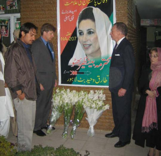 Representative Patrick Kennedy and Senator Arlen Specter (flanking poster) paid their respects yesterday in Islamabad.