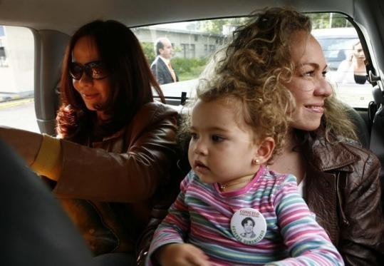 Sisters Patricia Perdomo and Maria Fernanda Perdomo, with her child, arrived at a military airport in Bogota, before traveling to Caracas to wait for their mother's possible release.
