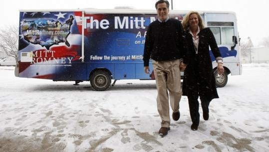 Mitt Romney arrives with his wife, Ann, to campaign in Sioux Center yesterday as part of a five-day bus tour across Iowa.
