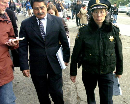 Police Chief Heather Fong (right) and Manuel Mollinedo, director of the San Francisco Zoo, as they left a news conference yesterday. One man was killed in the attack.