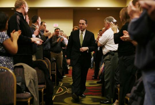 Republican presidential candidate Mike Huckabee received a warm welcome at a campaign event Thursday in Des Moines. The former Arkansas governor has refrained from directly criticizing rivals, pleasing Iowa voters who dislike negative campaigning.