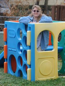 Laura Gernell of West Virginia stood inside an outdoor playset that she received from the Freecycle Network.