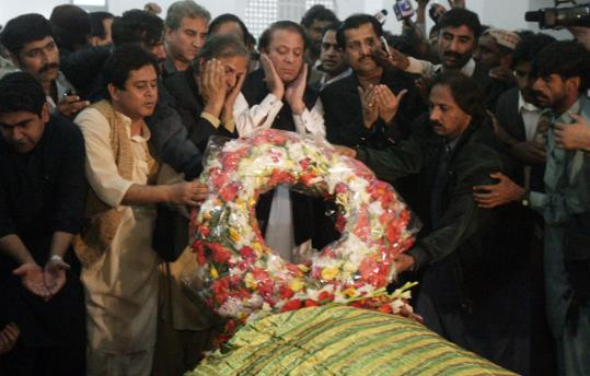 Nawaz Sharif (center, white sleeves), now Pakistan's most prominent opposition figure, visited the political stronghold of Benazir Bhutto to lay a wreath on her grave in Ghari Khuda Baksh.