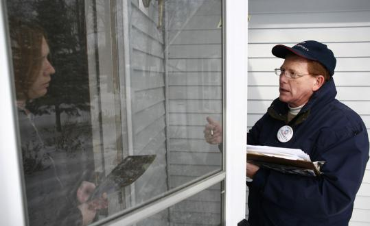 Mike Jordan, a supporter of Democratic presidential candidate Barack Obama, talked to Emily Overbeck, while canvassing a neighborhood in Cedar Rapids, Iowa, last month.