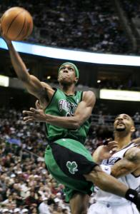 Rajon Rondo gives the slip to Utah forward Carlos Boozer and lays in 2 points for the Celtics in the first quarter.