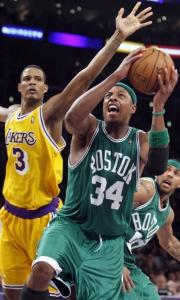 Boston's Paul Pierce, who had 33 points, gets off a shot despite the defense of the Lakers' Trevor Ariza.