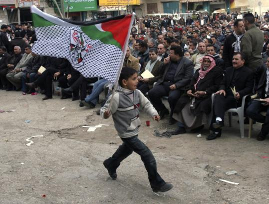 A Palestinian boy marched in a rally marking the 43d anniversary of the Fatah movement, in the West Bank town of Jenin yesterday. Gaza's ruling Hamas militant group launched a new crackdown on the rival Fatah movement yesterday.