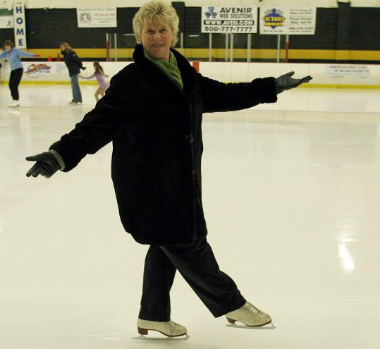 Dorothy Cunningham takes a spin at Norfolk Arena, one of the area rinks where she teaches ice skating.