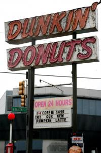 Dunkin' Donuts is replacing this North Beacon Street sign, which some say dates to 1957. Preservationists would like to see the sign restored or salvaged.