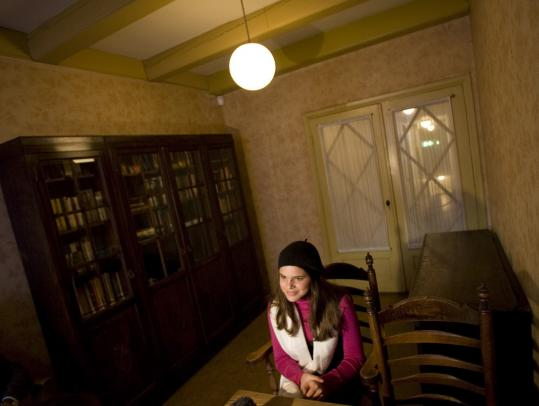 Isabella Castillo, who plays Anne in a Spanish theater troupe's version of 'The Diary of Anne Frank,' sat in the office of Otto Frank, Anne's father, at the Anne Frank Museum in Amsterdam.