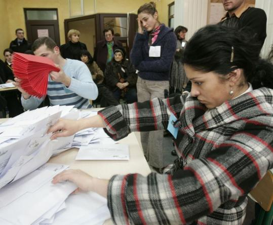 Election workers counted ballot papers yesterday after polls closed in Tbilisi, Georgia. National election officials were expected to announce preliminary official results early today.
