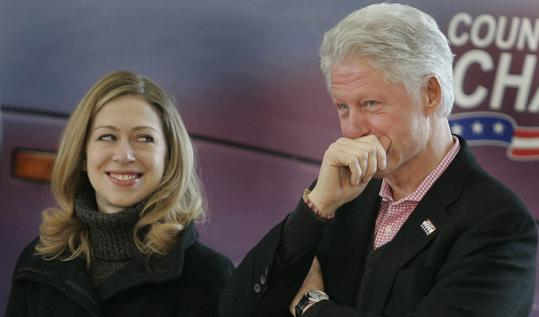 Former president Bill Clinton and his daughter, Chelsea, stood in a hangar at Nashua Airport on Friday while Hillary Clinton delivered her stump speech at a morning rally.