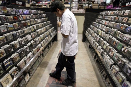 With in-store music sales slumping, record companies are considering a host of ways to make money off of digital content.