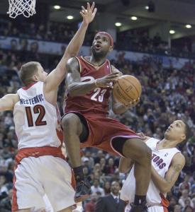 Toronto's Jamario Moon (right) gets a good look at LeBron James's flight of fancy above Raptors center Rasho Nesterovic in the fourth quarter.