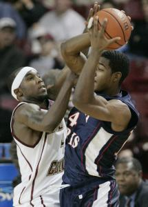 BC's Tyrese Rice (left), who was held to 10 points, tries his hand at playing some defense against Robert Morris's Gary Wallace.