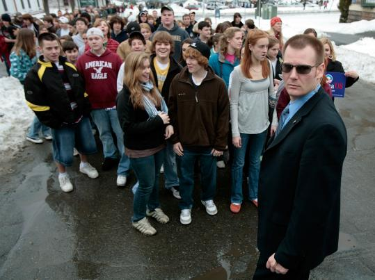 A Secret Service agent held back a group of young people as the Obama motocade went past a rally yesterday in Claremont, N.H. The senator from Illinois is drawing enthusiastic backing among New Hampshire's newly active, often younger Democrats.