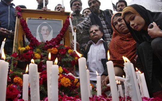 Supporters of Pakistan's Benazir Bhutto lit candles in Karachi, Pakistan yesterday for the slain opposition leader.