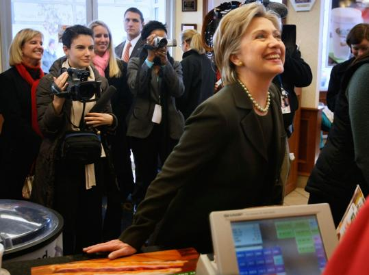 Senator Hillary Clinton ordered a beverage at a Dunkin' Donuts in Concord, N.H. yesterday, before visiting polling stations.