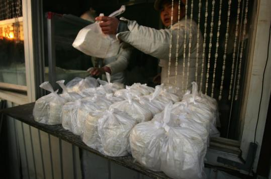 China firms will be banned from making, selling, or using bags less than 0.00098 inches thick. The ban takes effect June 1.