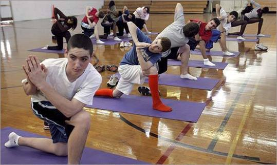 Students practiced yoga during a physical education elective at Norwood High.